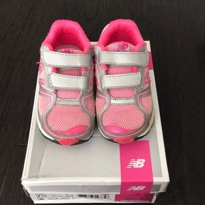 Lightly worn toddler New Balance running shoes